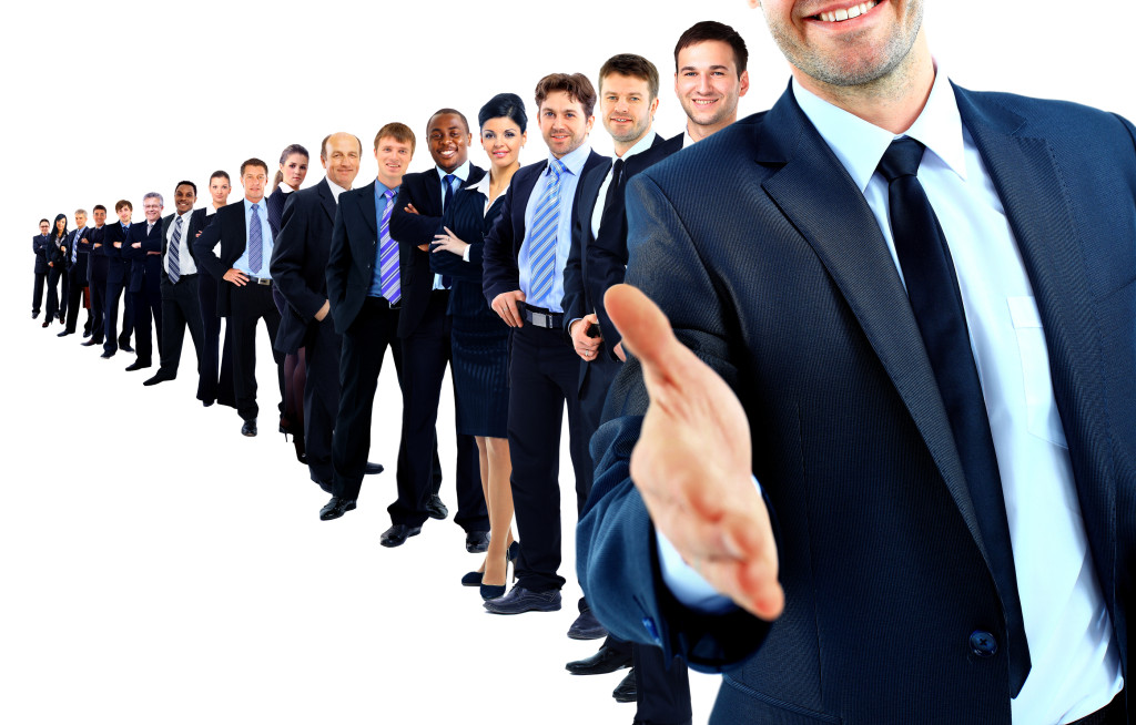 http://www.dreamstime.com/royalty-free-stock-photography-business-group-row-leader-open-hand-image37707187